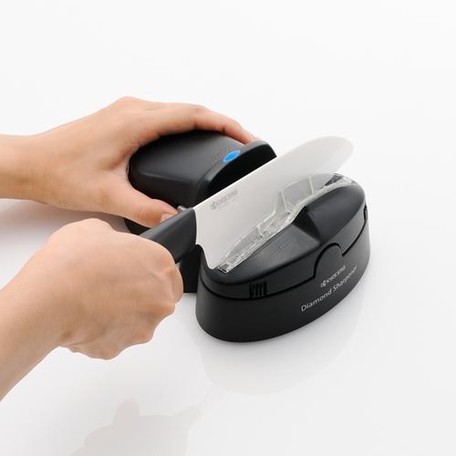 משחיז סכינים חשמלי עם גלגל יהלום לסכינים Kyocera